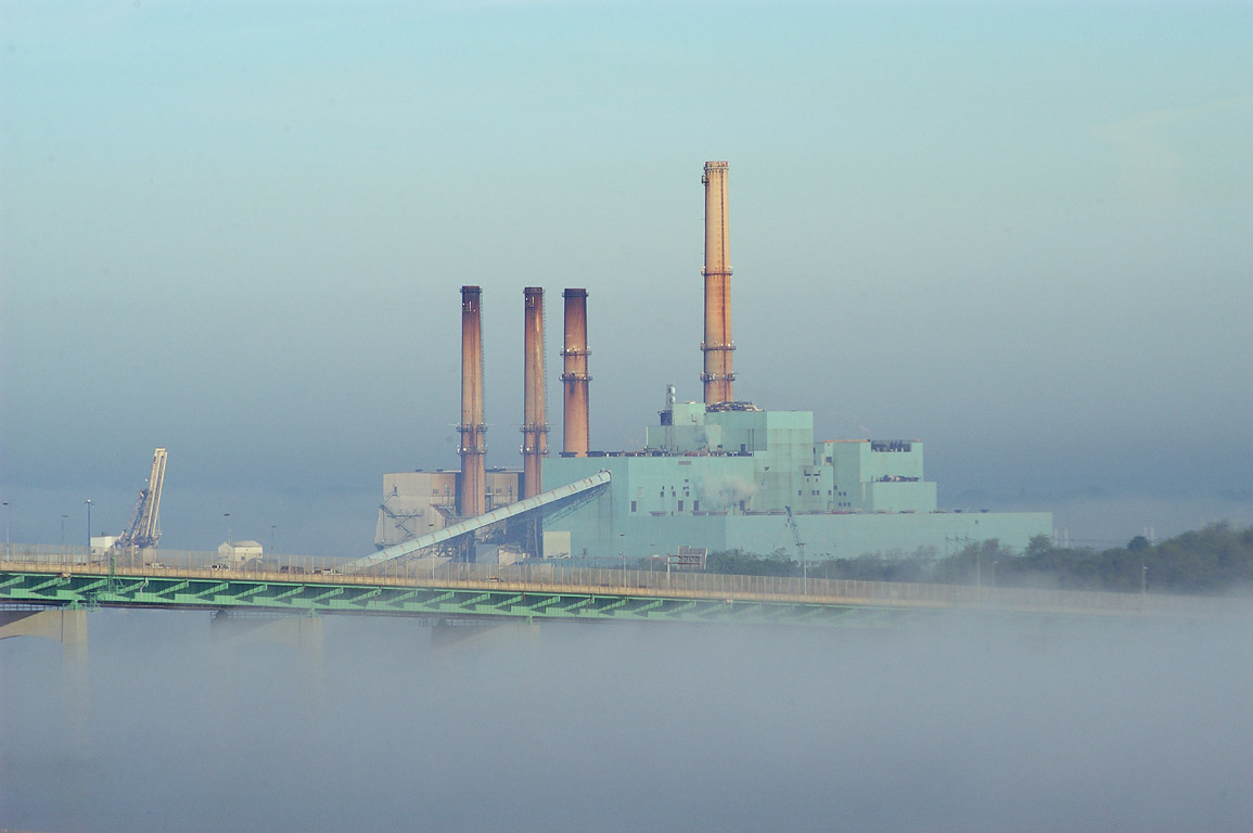 Brayton Point powerplant in fog from an apartment...at morning. Fall River, Massachusetts