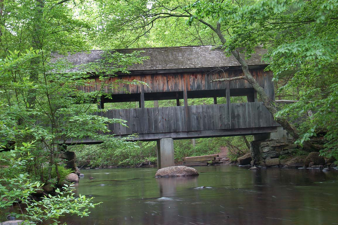 A covered bridge of Eightmile River in Devils Hopyard State Park. East Haddam, Connecticut