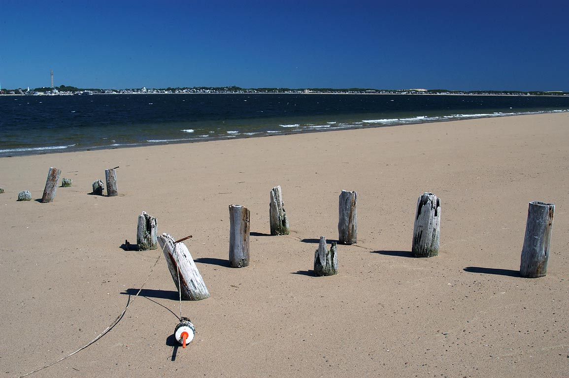 Remains of docks on Long Point beach in Cape Cod. Provincetown, Massachusetts