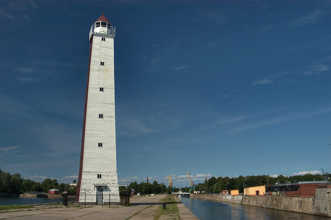A lighthouse and Peter's Channel (Petrovskiy Dock) in Kronstadt. St.Petersburg, Russia