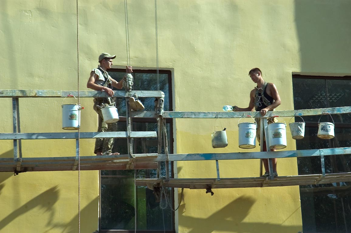 Construction workers, view from a tourist bus. Pskov, Russia