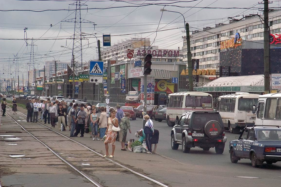 People waiting a tram near Pionerskaya Subway...left turn. St.Petersburg, Russia