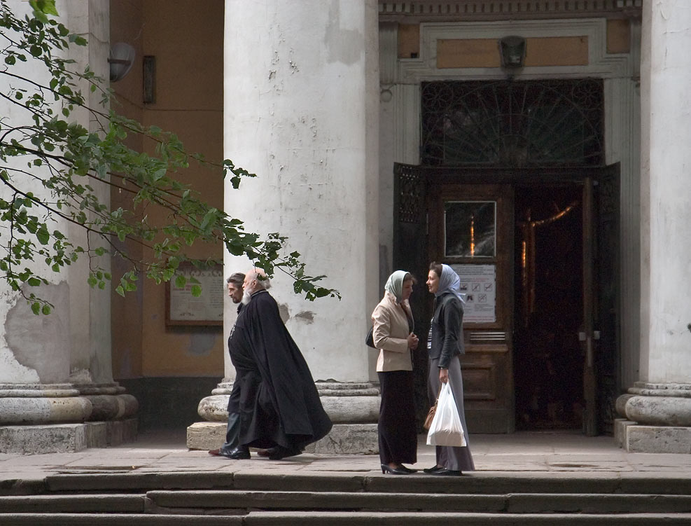 Clergymen in front of Holy Trinity Cathedral of...Nevsky Lavra. St.Petersburg, Russia