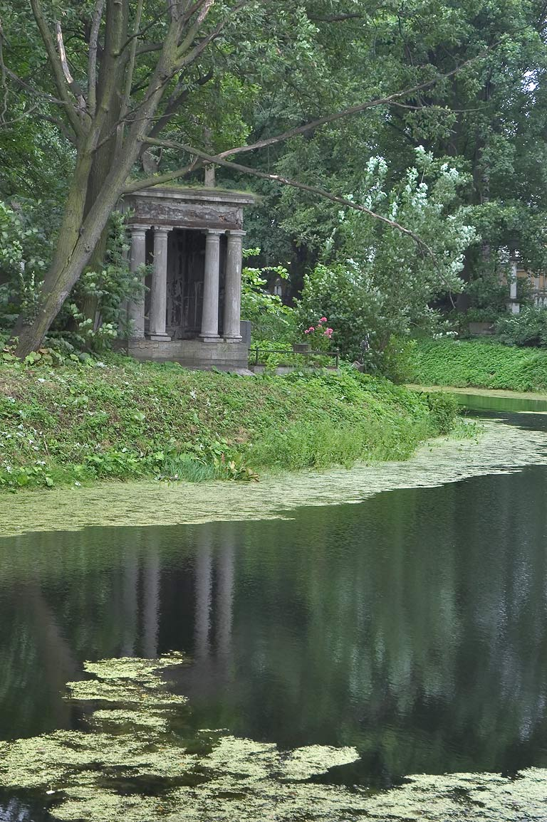 A crypt and a pond in Nikolskoe Cemetery of Alexander Nevsky Lavra. St.Petersburg, Russia