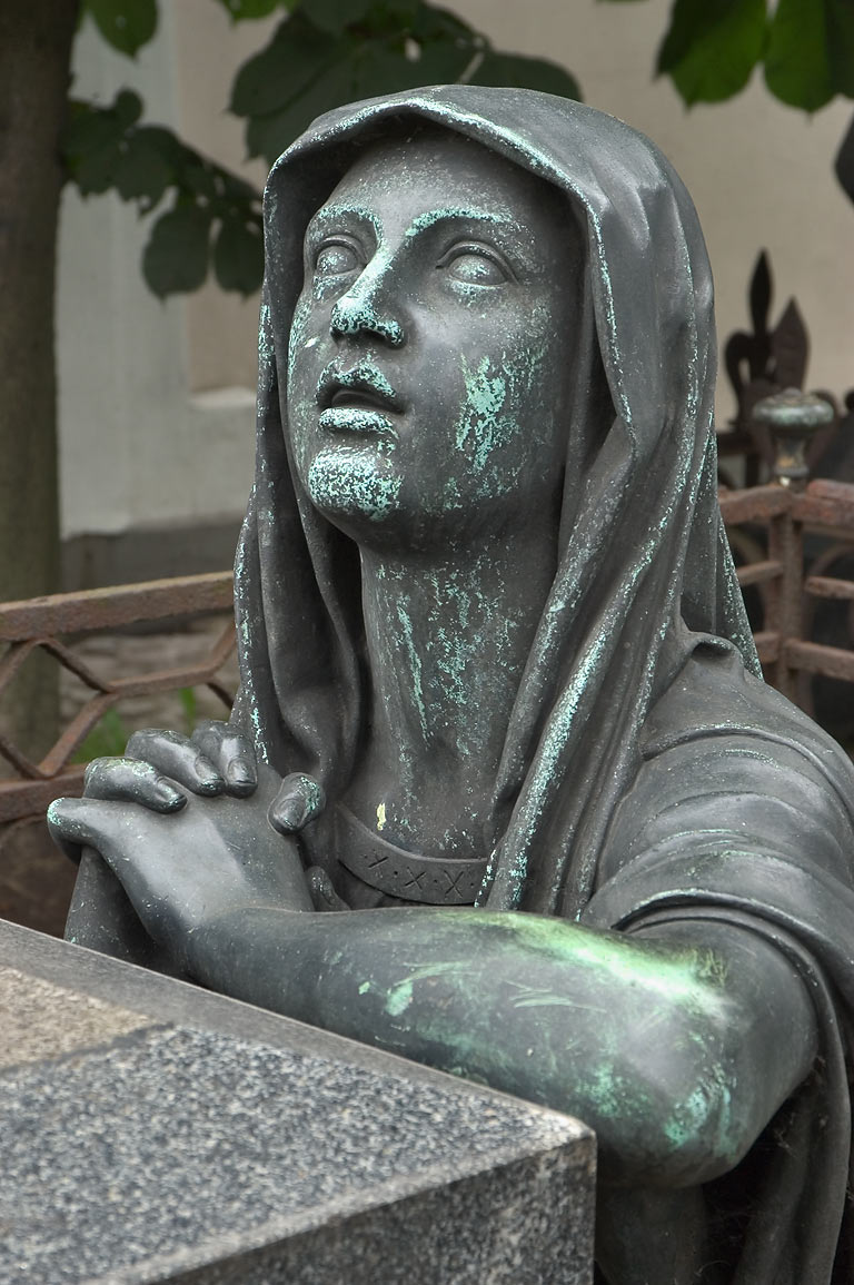 A statue on a tombstone in Necropolis of...Cemetery). St.Petersburg, Russia