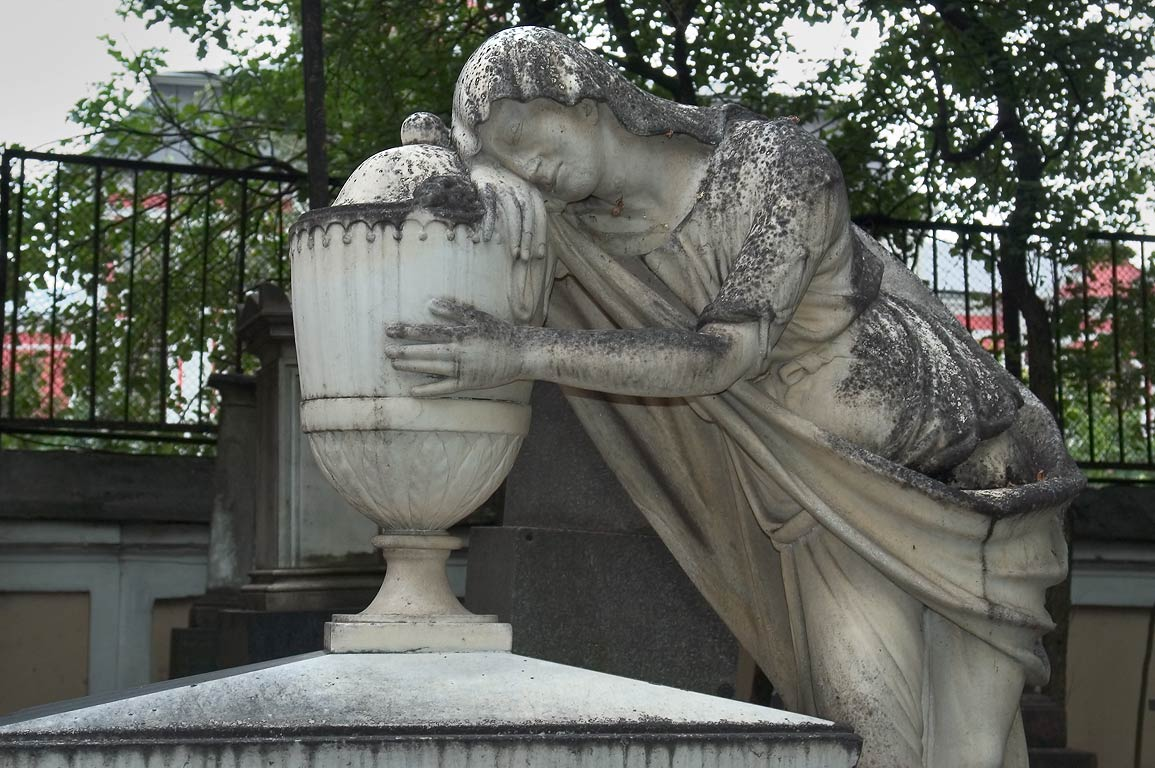 A marble tombstone in Necropolis of Alexander...Cemetery). St.Petersburg, Russia