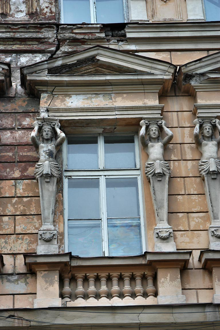 Sculptures of a building on Bunina Street. Odessa, Ukraine