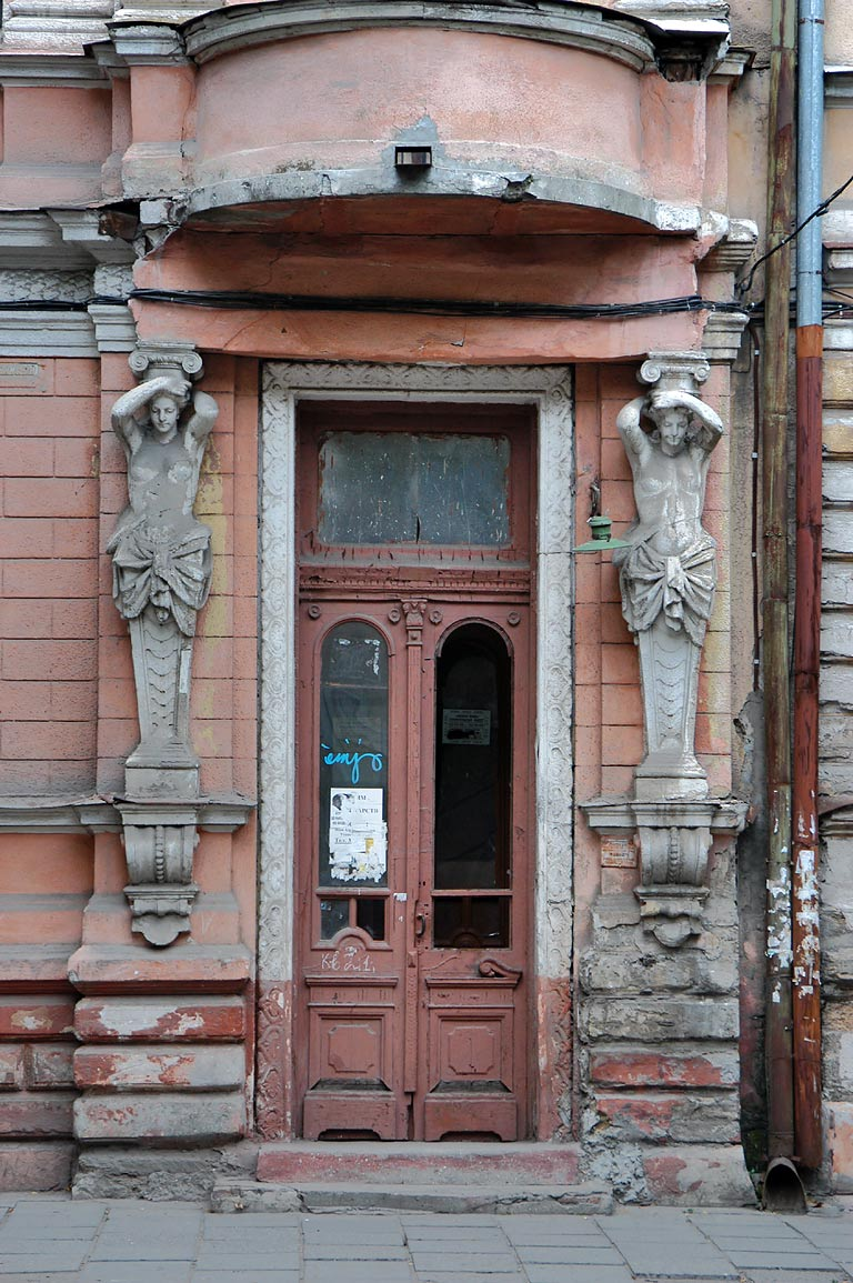 A doorway and sculptures on Kanatnaya Street. Odessa, Ukraine