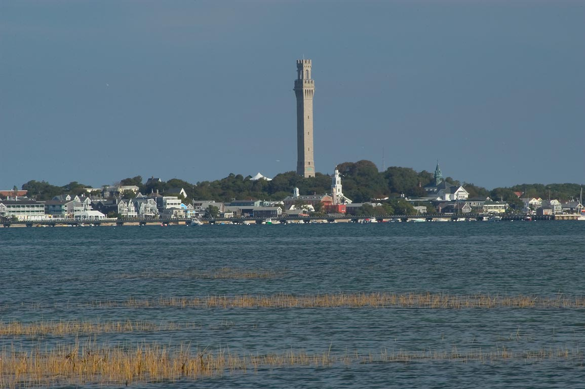 Moor, Pilgrim Monument and Provincetown in Cape...from Long Point Beach. Massachusetts