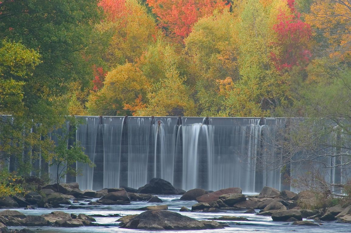 Rolling Dam and fall colors of Blackstone Gorge. Woonsocket, Rhode Island