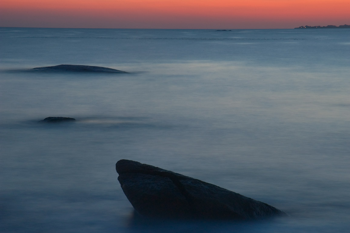 Boulders in Atlantic Ocean after sunset at the...from Acoaxet. Westport, Massachusetts