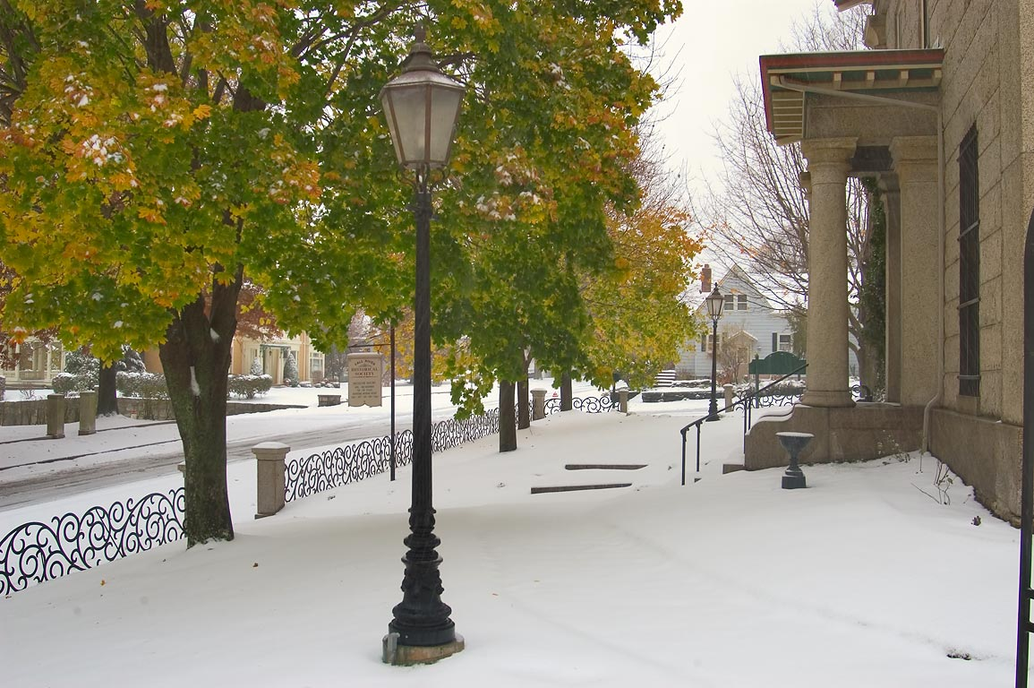 Early snowfall on Rock St. near Museum of Fall...District. Fall River, Massachusetts