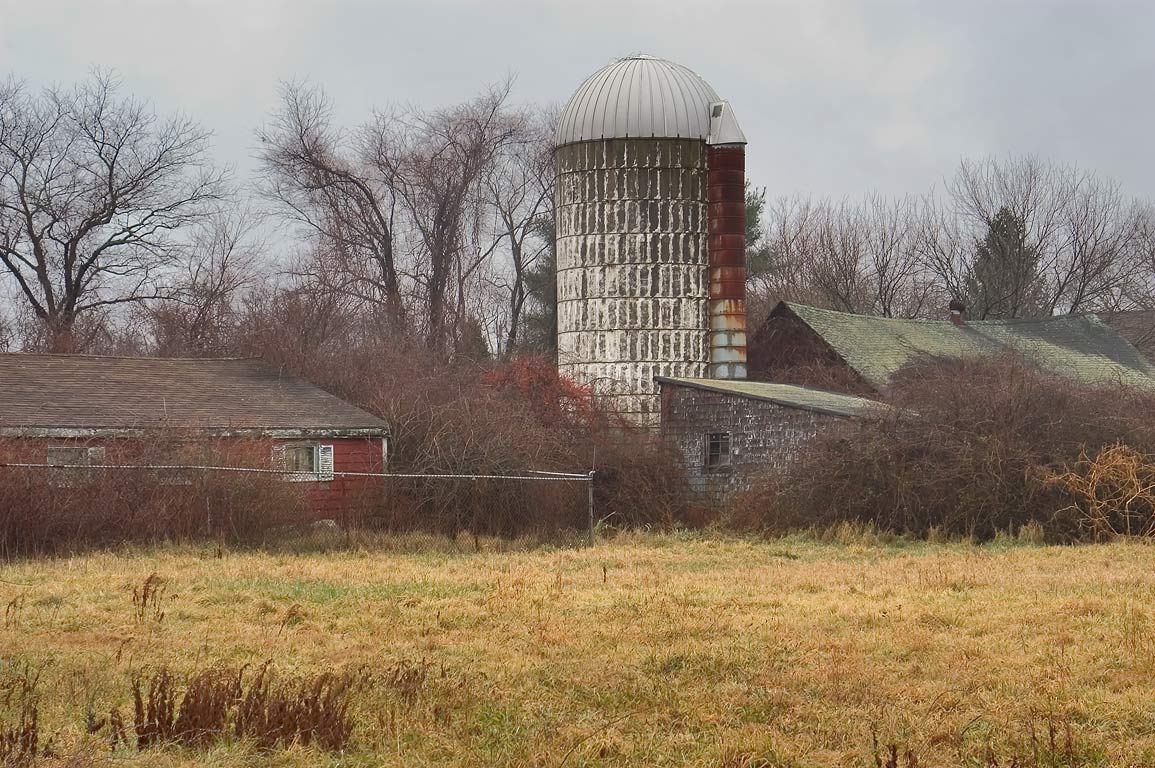 A silo and a farm near Route 81 west from Stafford Pond. Tiverton, Rhode Island