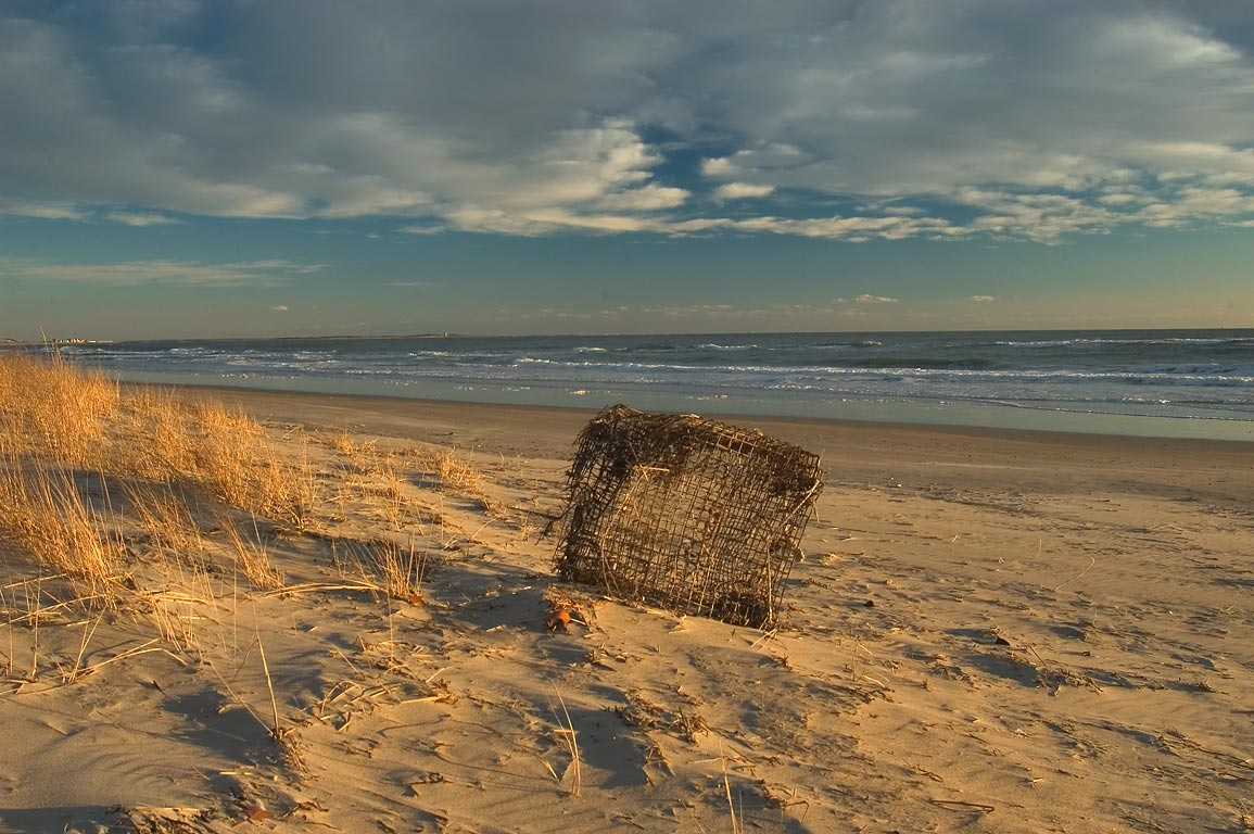 A lobster trap, now useful as a beach chair on Horseneck Beach. Westport, Massachusetts