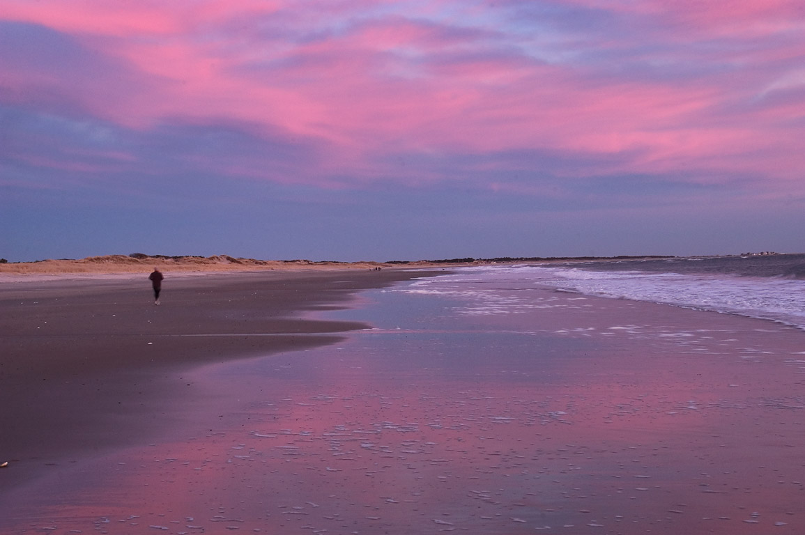 A jogger on Horseneck Beach at dusk. Westport, Massachusetts