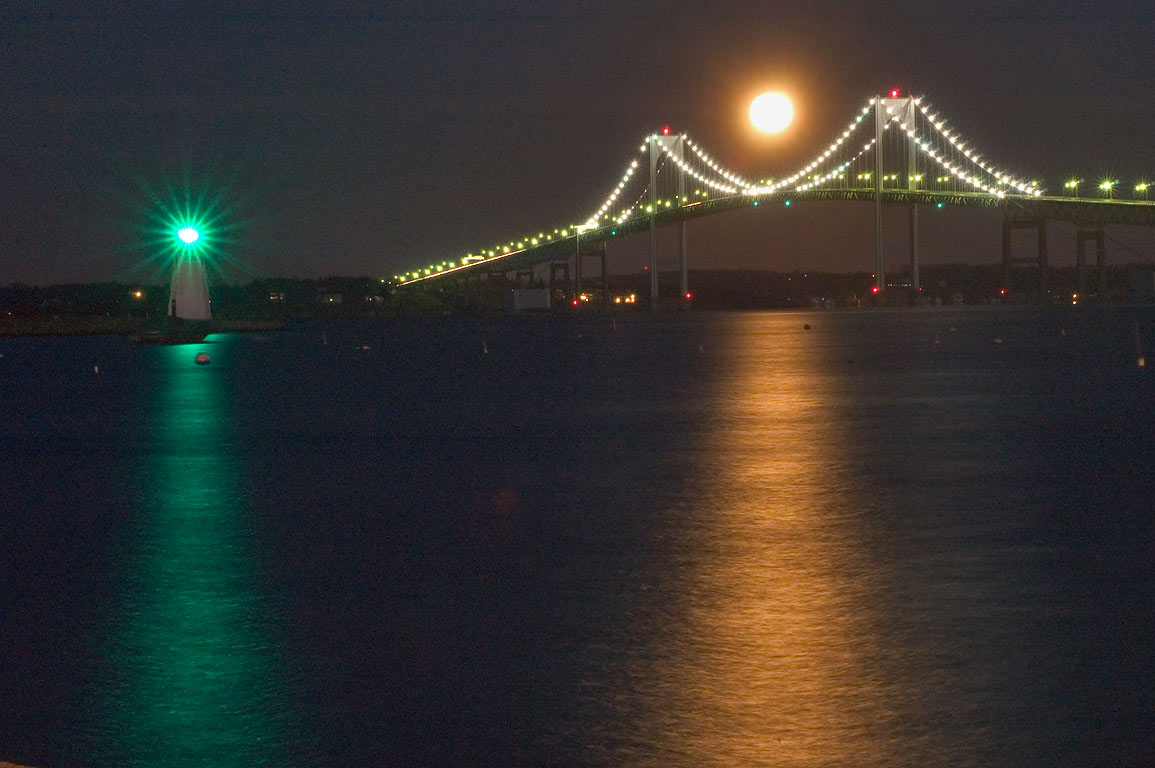 Moonset over Newport Bridge, view from Goat Island connector. Newport, Rhode Island