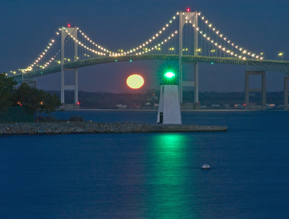 Newport Bridge and Goat Island Lighthouse at...connector. Newport, Rhode Island