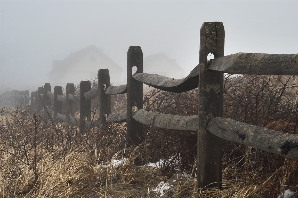 A fence between Atlantic Ave. and a beach south from Adamsville, in fog. Massachusetts