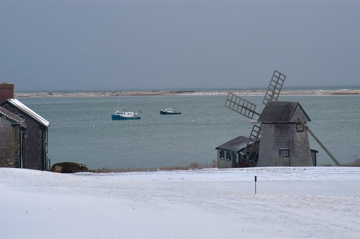 A windmill and fishing boats, view from Shore Rd. in Cape Cod. Chatham, Massachusetts
