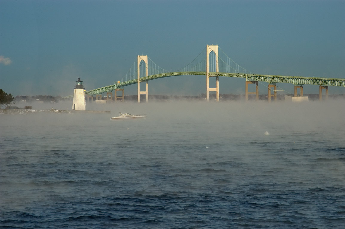 Goat Island Lighthouse and Newport Bridge in...connector. Newport, Rhode Island