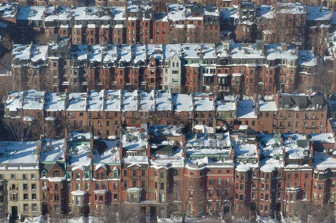 Rows of houses behind Commonwealth Ave. between...Tower. Boston, Massachusetts