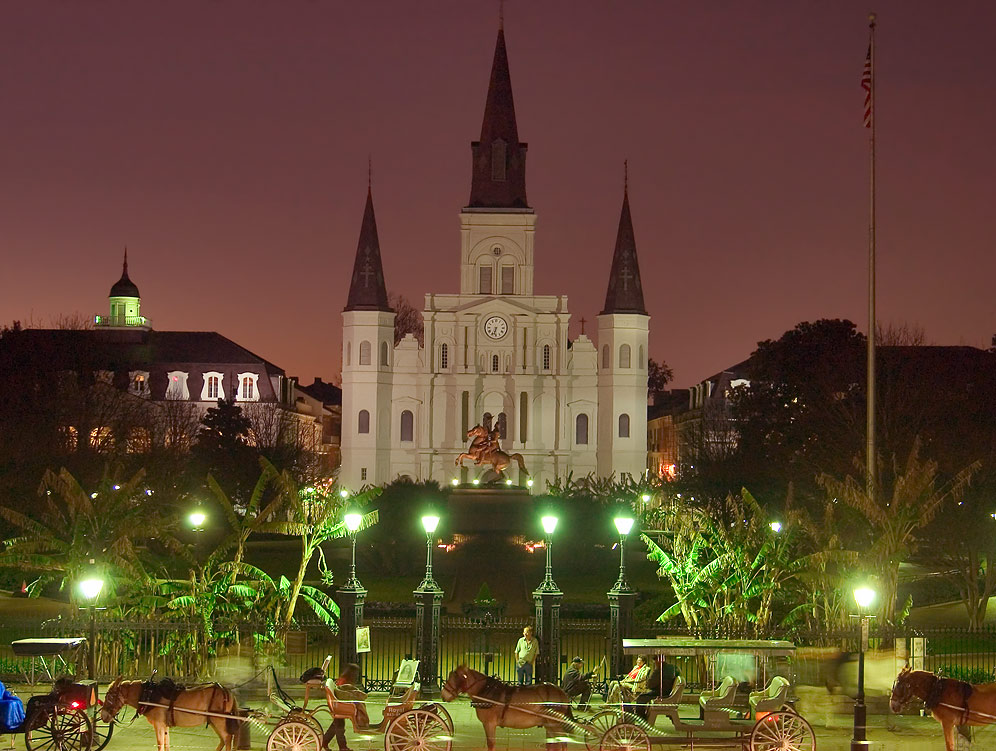 Jackson Square with carriages and St.Louis Cathedral at evening. New Orleans, Louisiana