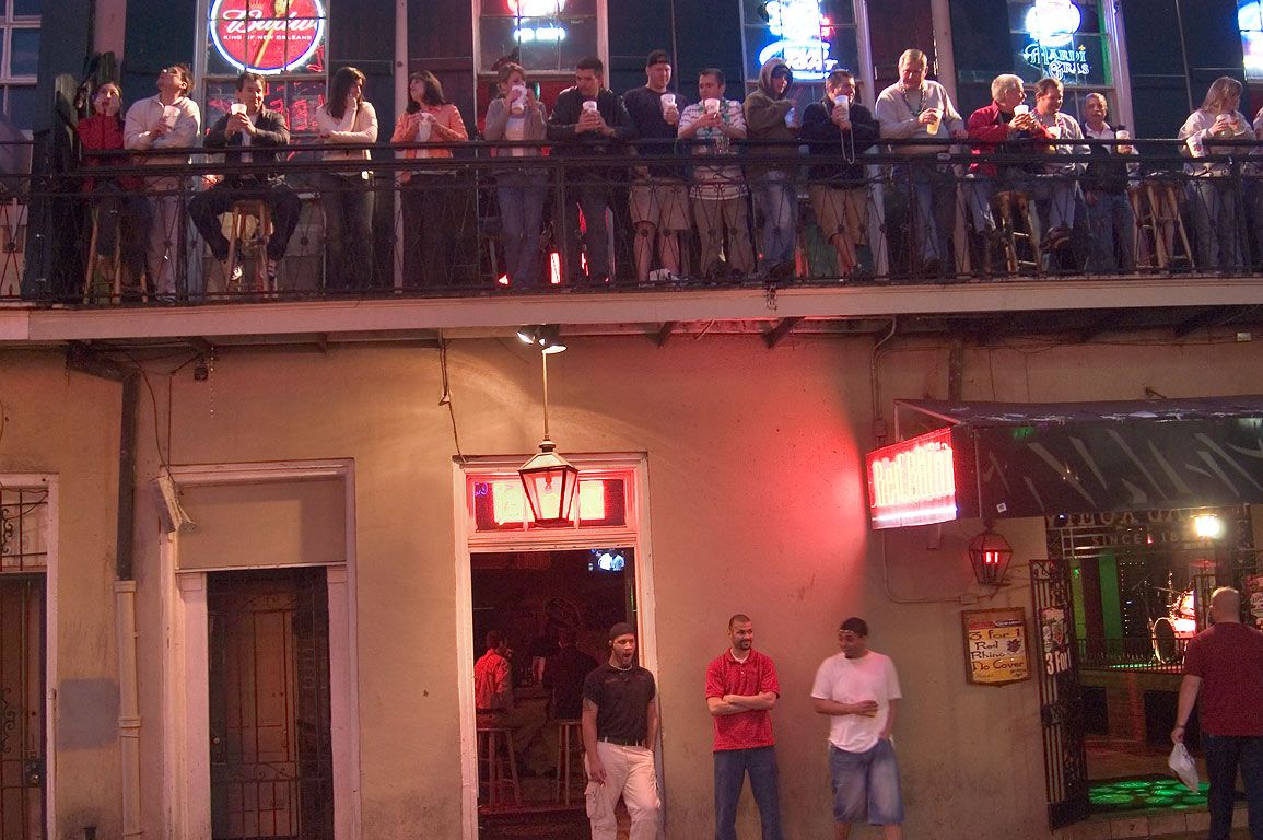 A pub with tourists on Bourbon Street. New Orleans, Louisiana