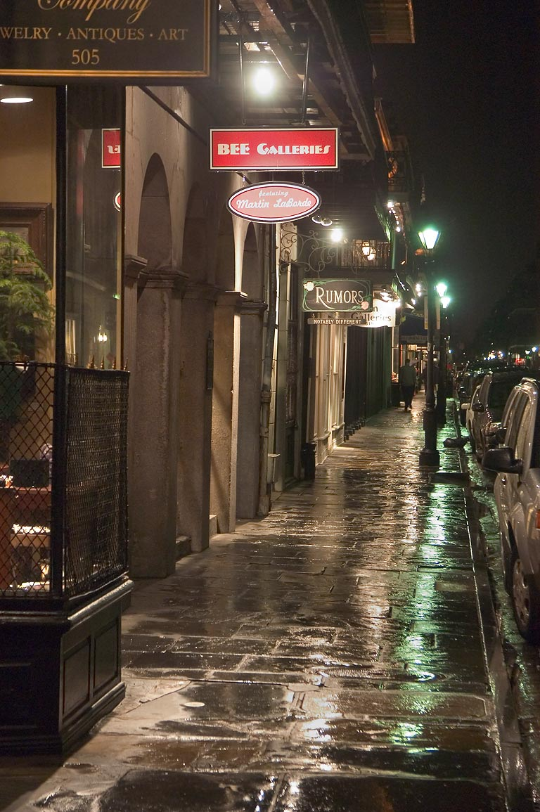 Art galleries on Royal St. at rainy evening. New Orleans, Louisiana