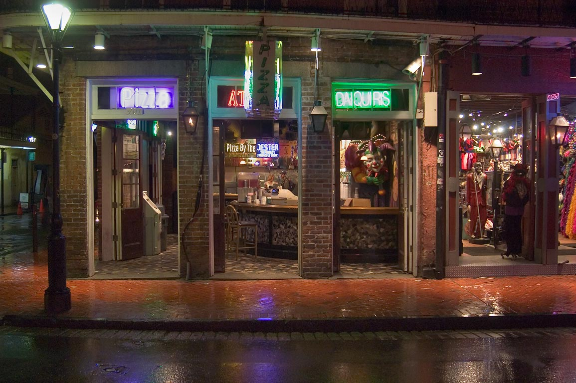 A pizza shop on Bourbon Street at rainy evening. New Orleans, Louisiana