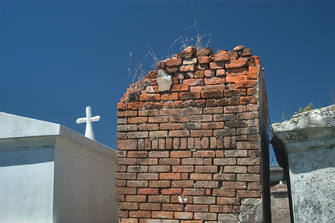A cross and a tomb in St.Louis Cemetery No. 2. New Orleans, Louisiana