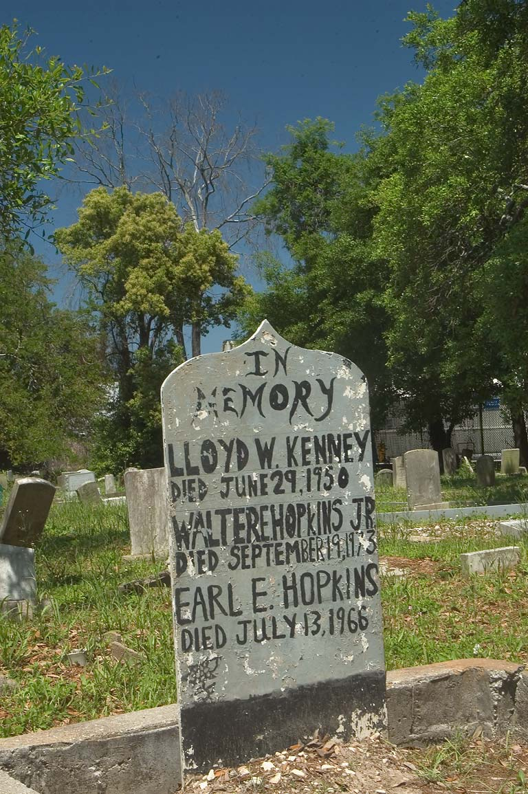 Peeled tombstone of Lloyd W. Kenney, Walter E...Holt Cemetery. New Orleans, Louisiana