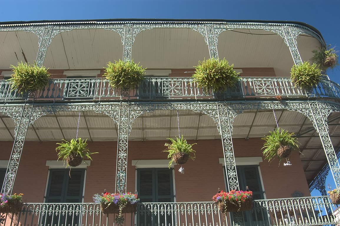 Iron balconies at a corner of St.Philip and Royal...French Quarter. New Orleans, Louisiana