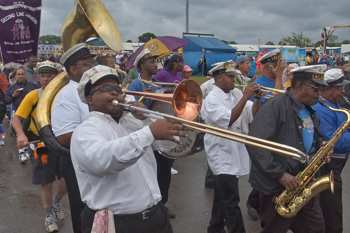 Algiers brass band marching during Jazzfest. New Orleans, Louisiana