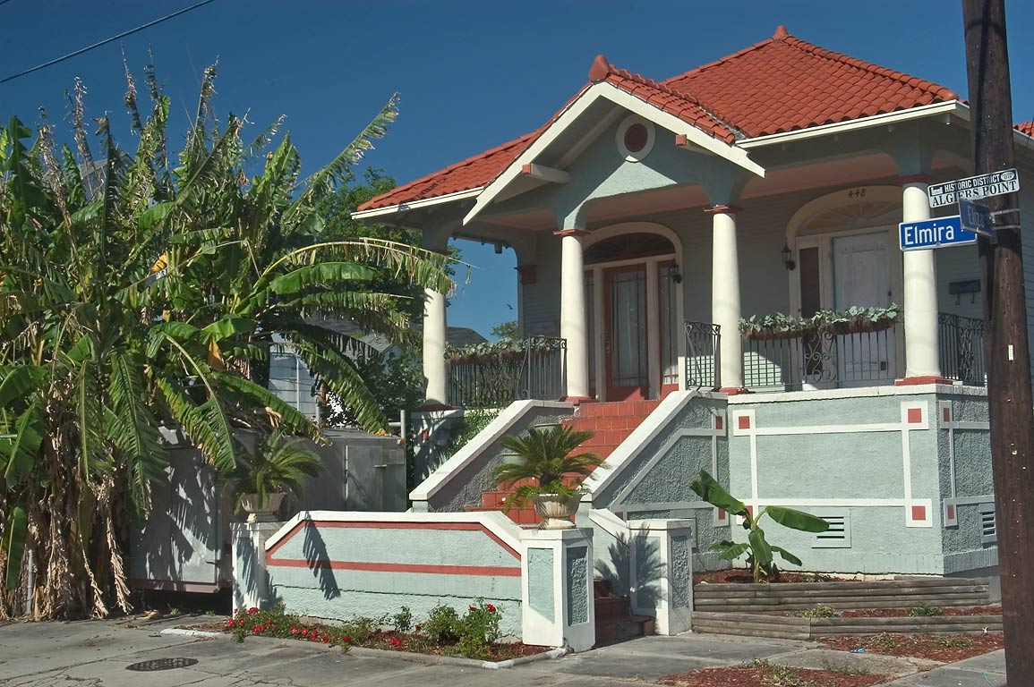 A house with banana and palms at a corner of...Algiers Point. New Orleans, Louisiana