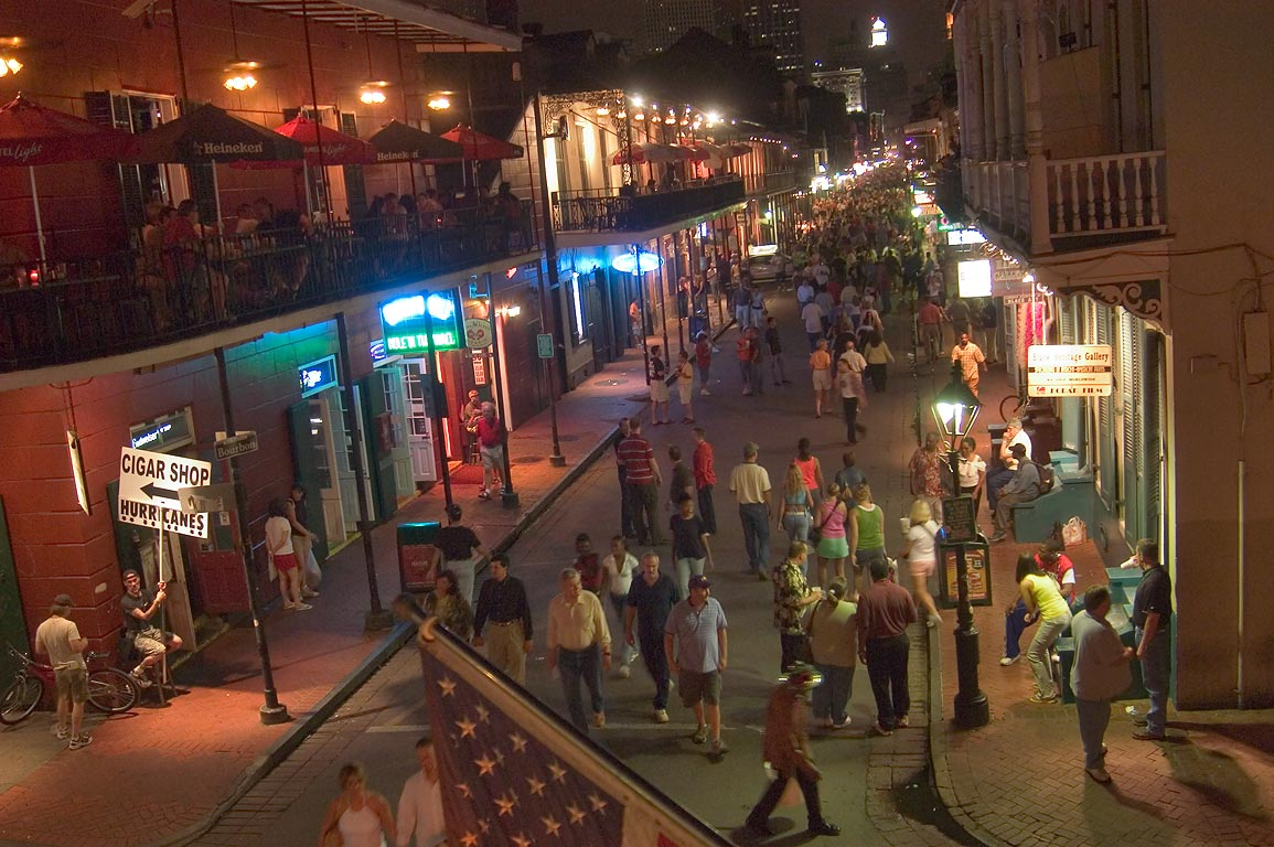 Bourbon Street at evening, view from a balcony of...at Orleans St.. New Orleans, Louisiana