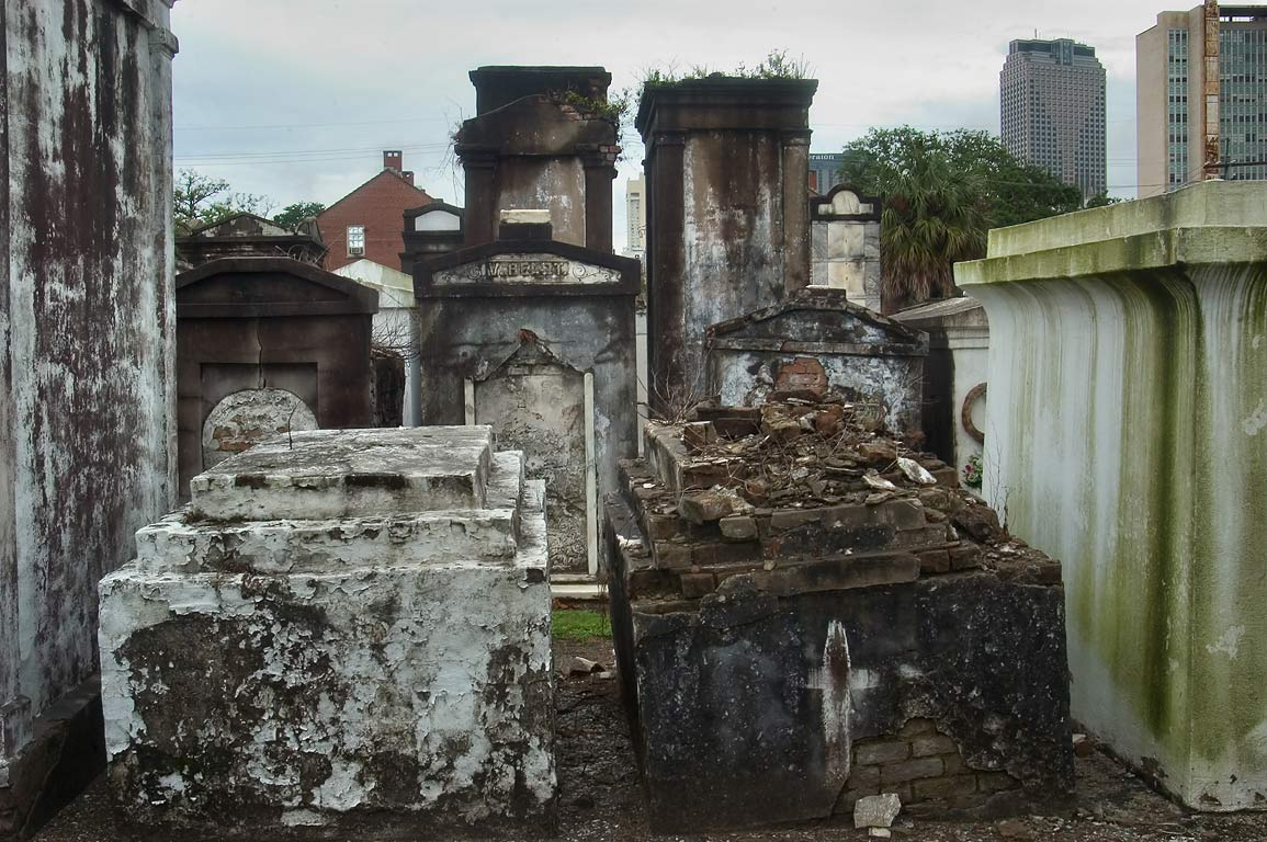 Tombs of St.Louis Cemetery No. 2, with cityscape in background. New Orleans, Louisiana