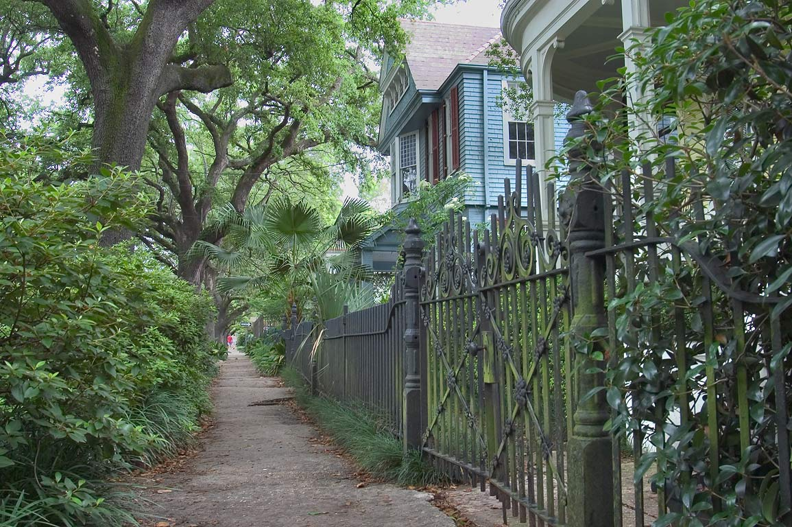 Southern sidewalk of St.Charles Ave. between...to the right. New Orleans, Louisiana