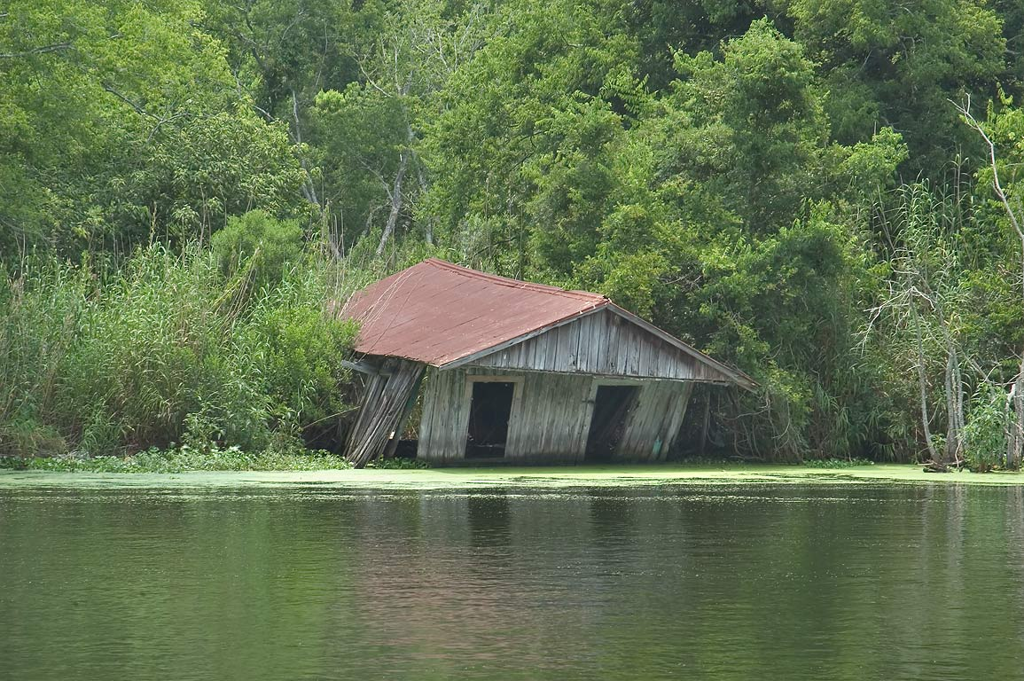 A shaky boat shed in Bayou Grand Caillou near Rd. 57, Terrebonne Parish. Dulac, Louisiana