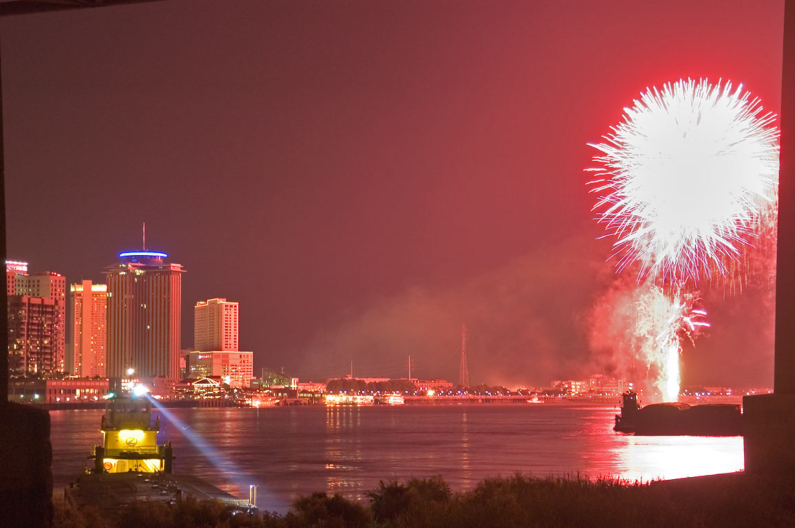 Cityscape and fireworks, view from a levee in Algiers. New Orleans, Louisiana