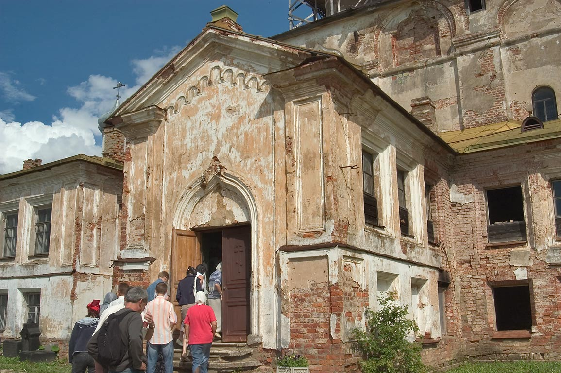 Excursion of ruins of Trinity church in Zelenets Monastery. Leningrad Region, Russia