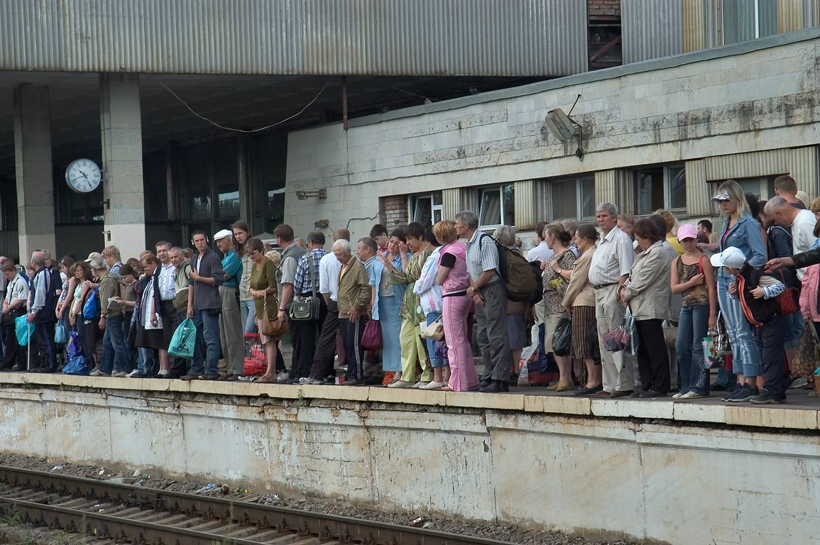 People waiting elektrichka (electric train) to go...Station. St.Petersburg, Russia