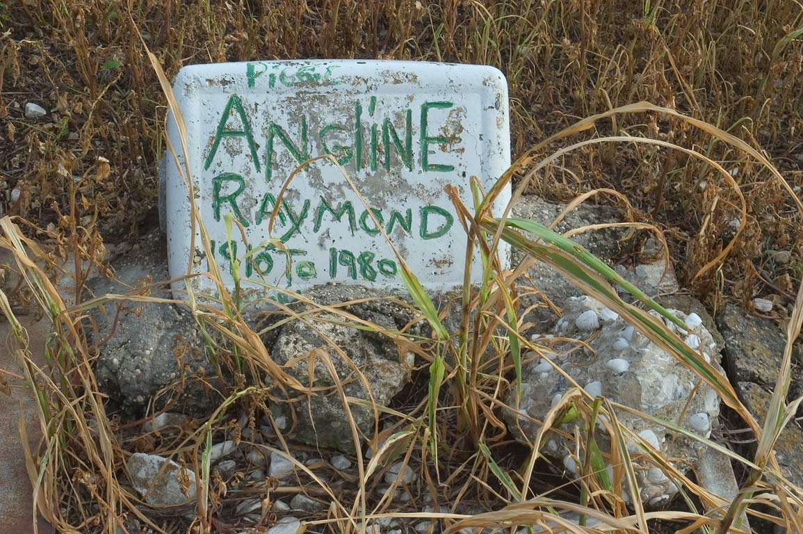 Tomb of Piggo Angline Raymond (1910-1980) in Holt Cemetery. New Orleans, Louisiana
