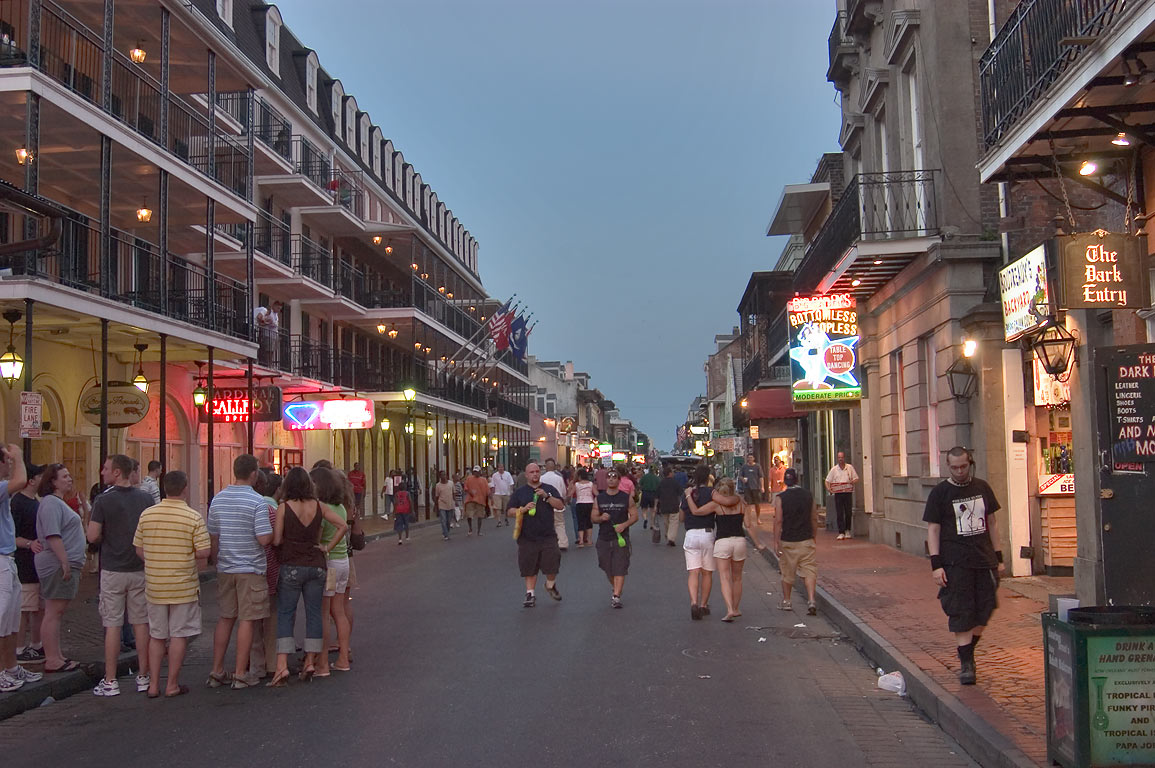 Bourbon Street at Saturday evening near Conti St...a hurricane). New Orleans, Louisiana