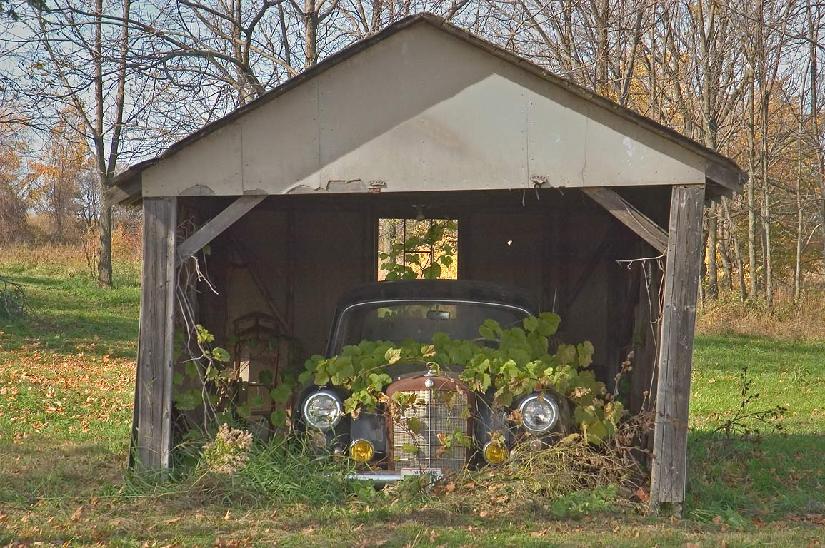 A garage with an old car near Newtown Rd.. Hector, New York
