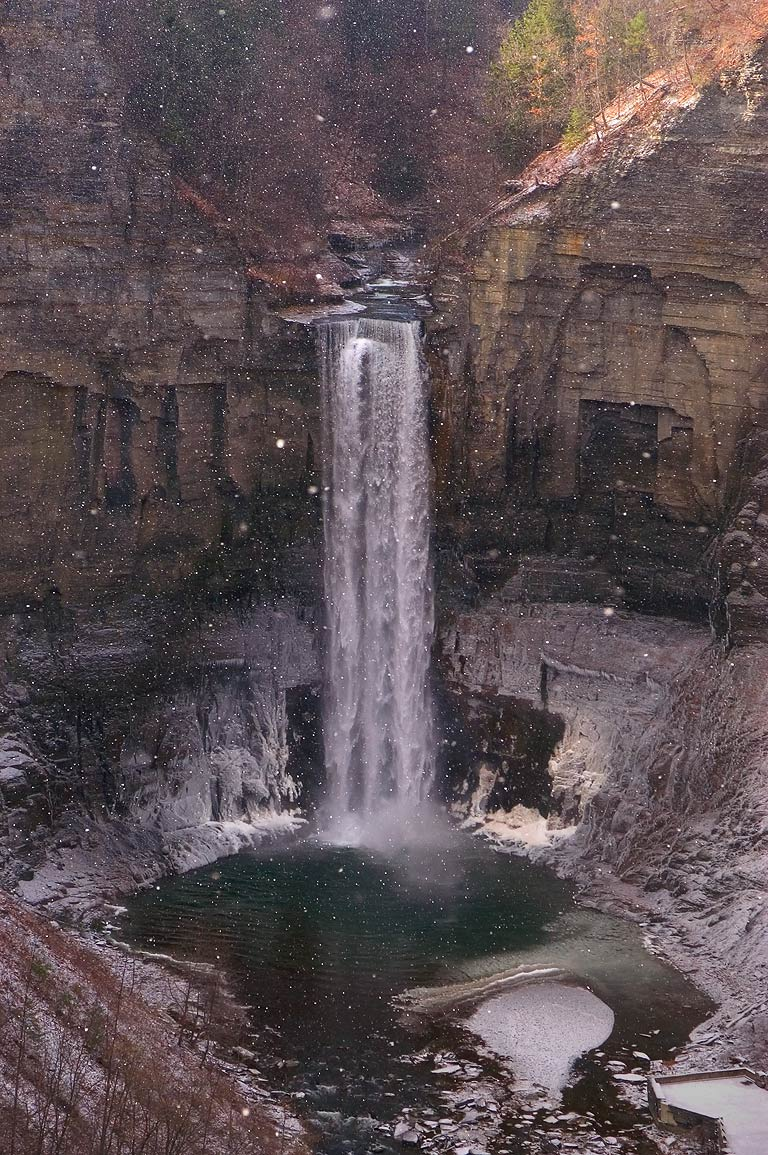 First snow at Taughannock Falls near Ithaca, view from upper falls overlook. New York