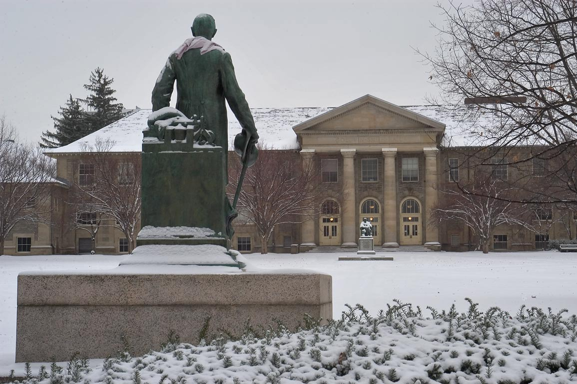 Ezra Cornell statue and Goldwin Smith Hall of...University, in snow. Ithaca, New York