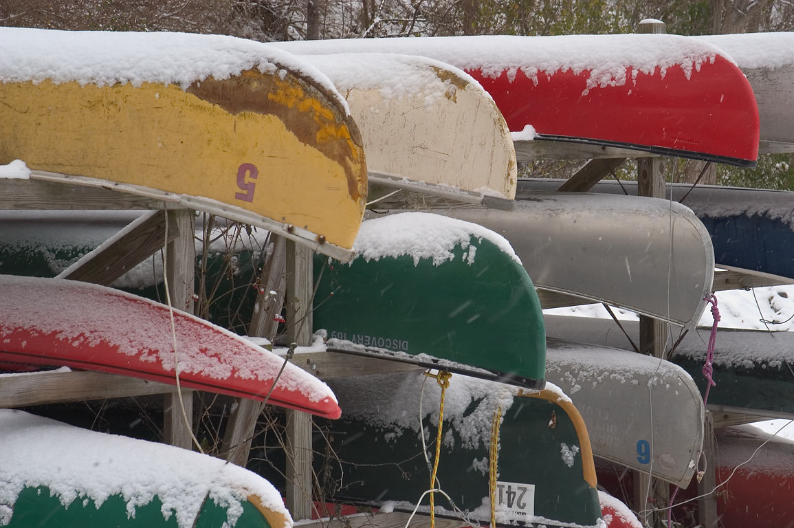 Stacked boats near Japes Lodge and Beebe Lake in...University, in snow. Ithaca, New York