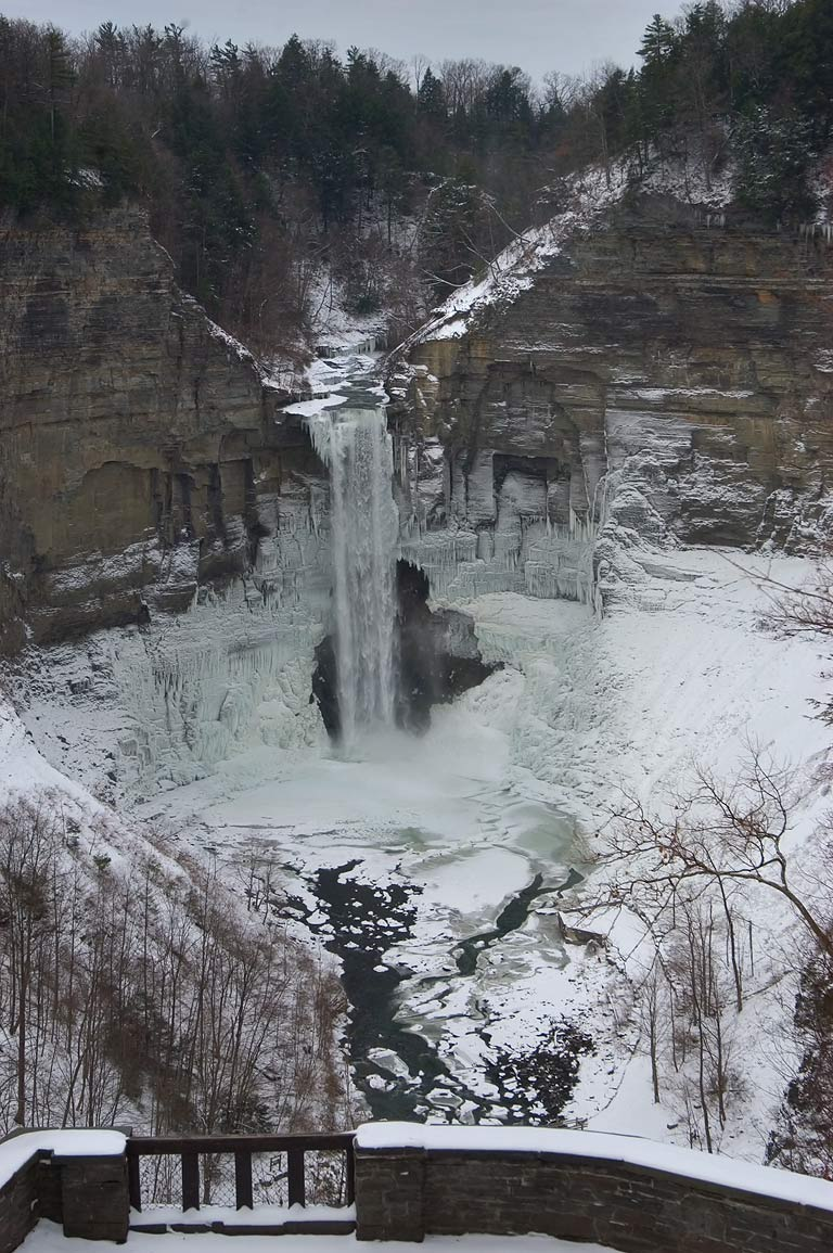 Frozen Taughannock Falls near Ithaca, view from upper falls overlook. New York