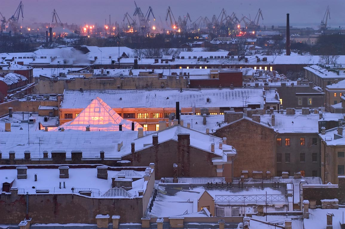 Roofs of old houses and sea port at horizon, view...at evening. St.Petersburg, Russia