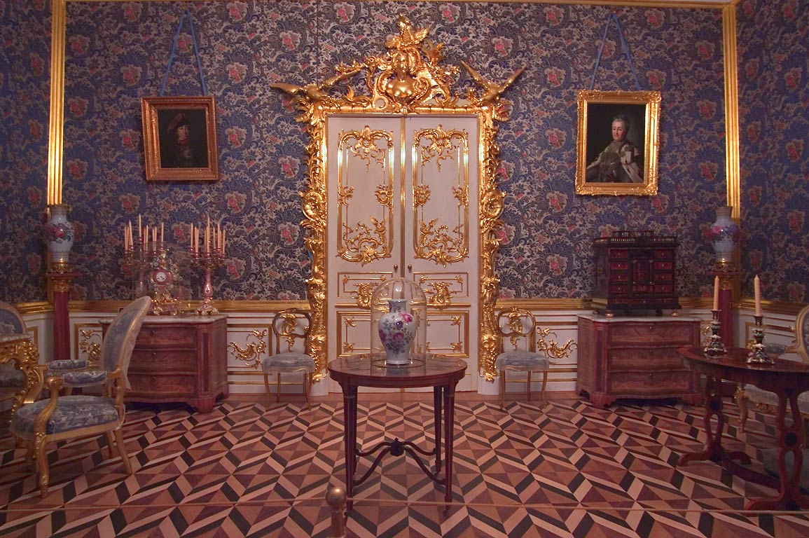 A decorated door and parquet floor in Grand Palace in Peterhof. Near St.Petersburg, Russia